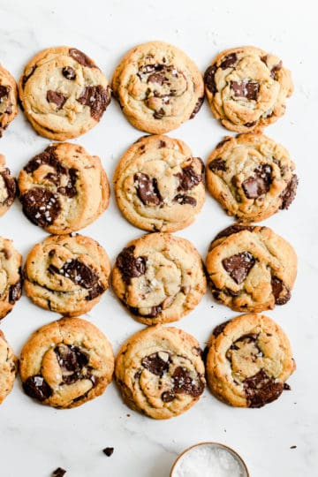 overhead shot of chocolate chip cookies sprinkled with salt