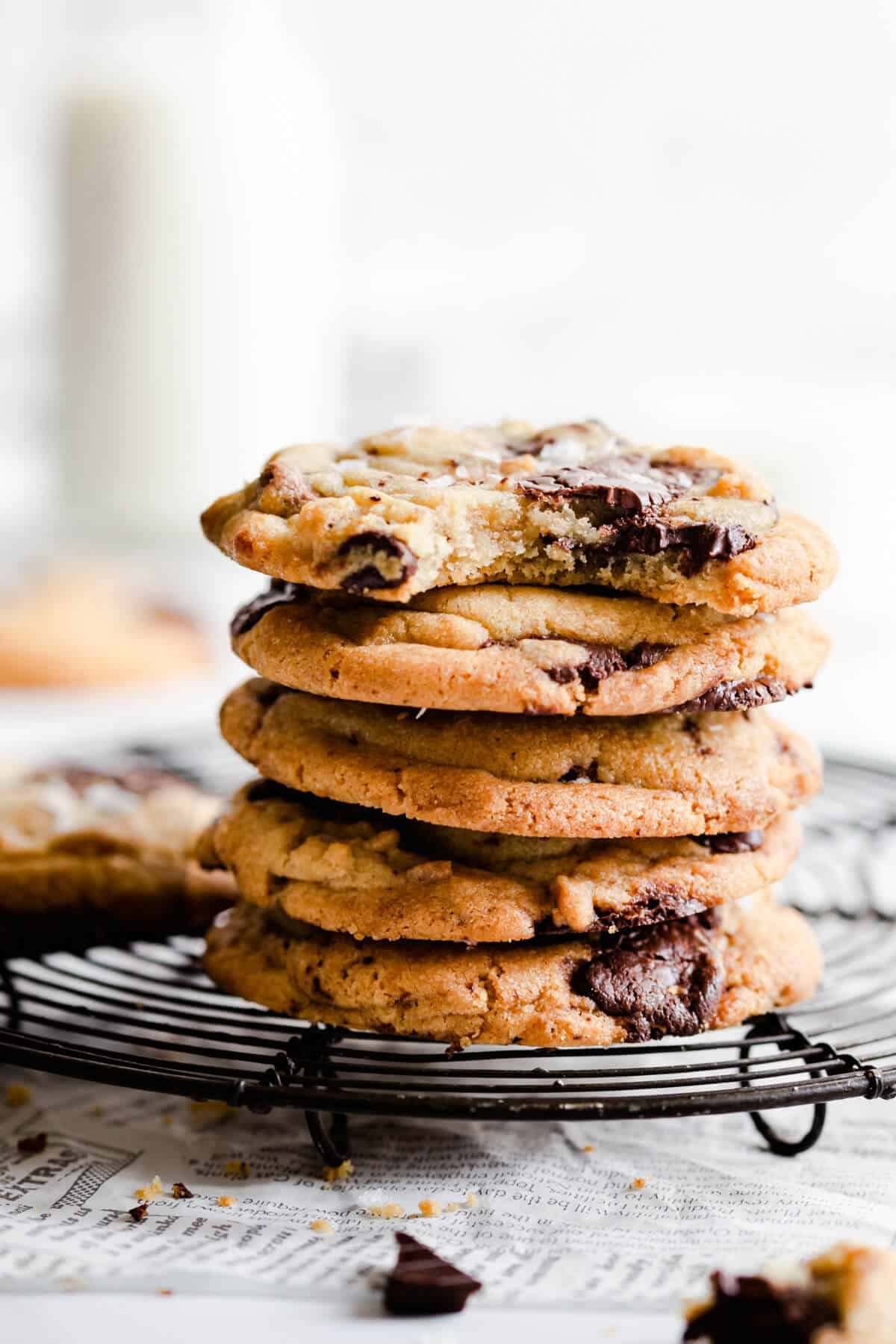 side close up of a stack of cookies with top cookie missing a bite
