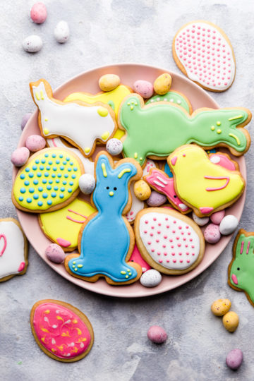 close up of unbaked sugar cookie dough cut outs