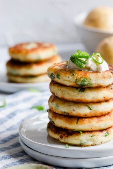 side close up of stack of potato patties with chives