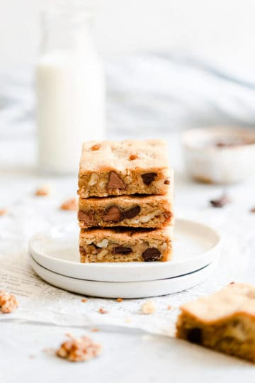 side shot of 3 square slices of chocolate chip and walnut blondies