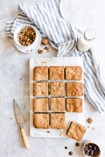 overhead shot of square blondies slices on hite chopping board