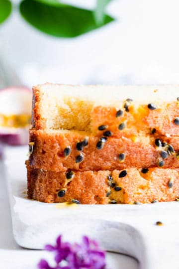 close up side angle photo of slices of passion fruit cake with bite taken out
