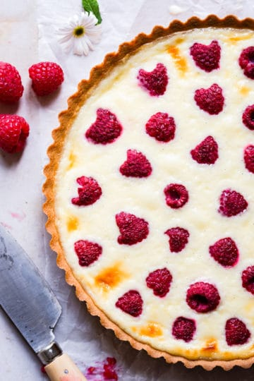 super close up from top on half of raspberry and mascarpone tart