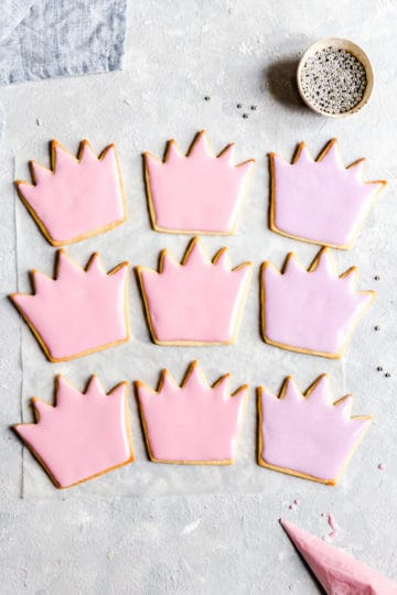 overhead shot of birthday sugar cookies decorated with pink and purple icing
