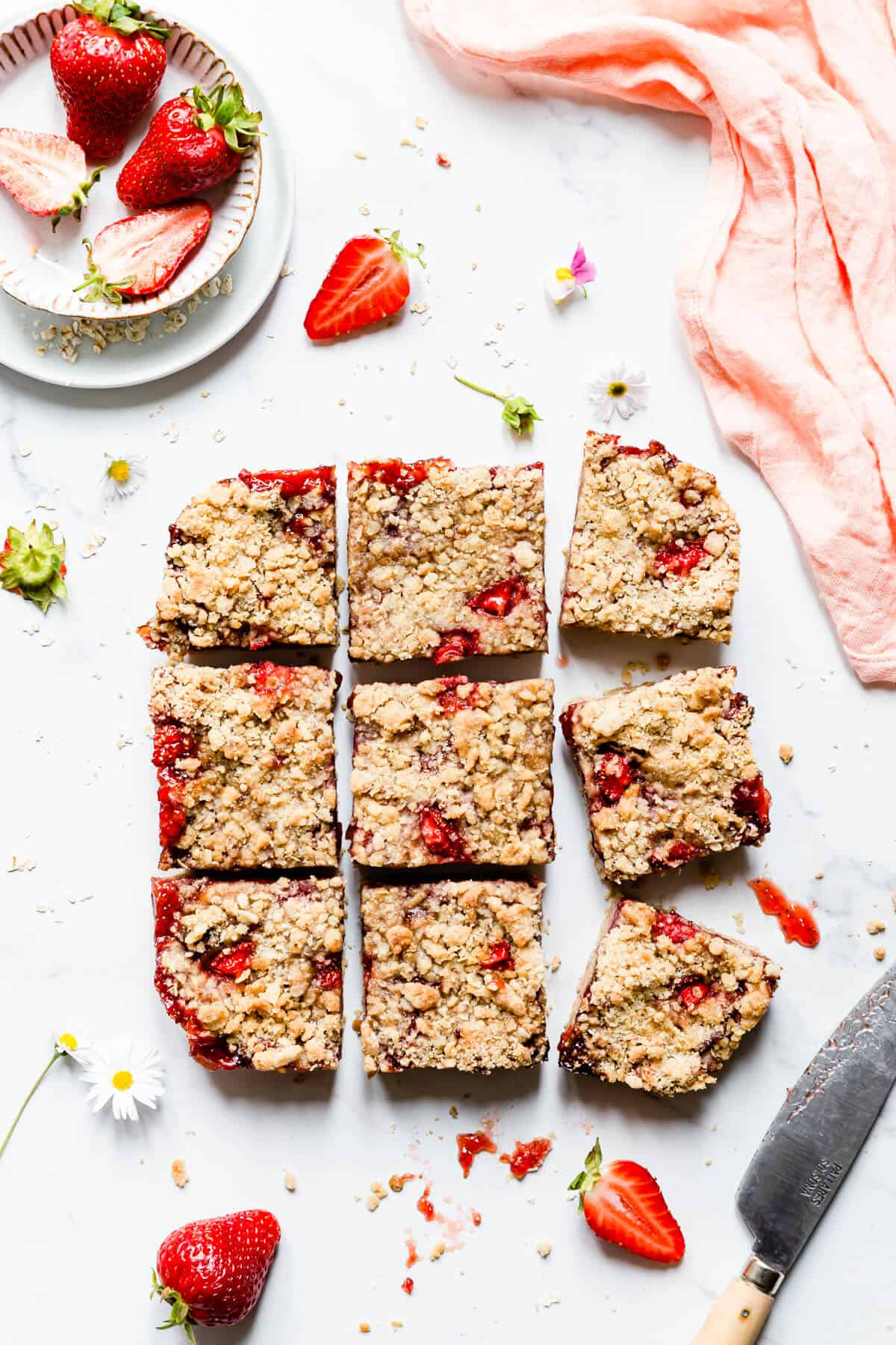 overhead shot of 9 square slices of strawberry crumble bars