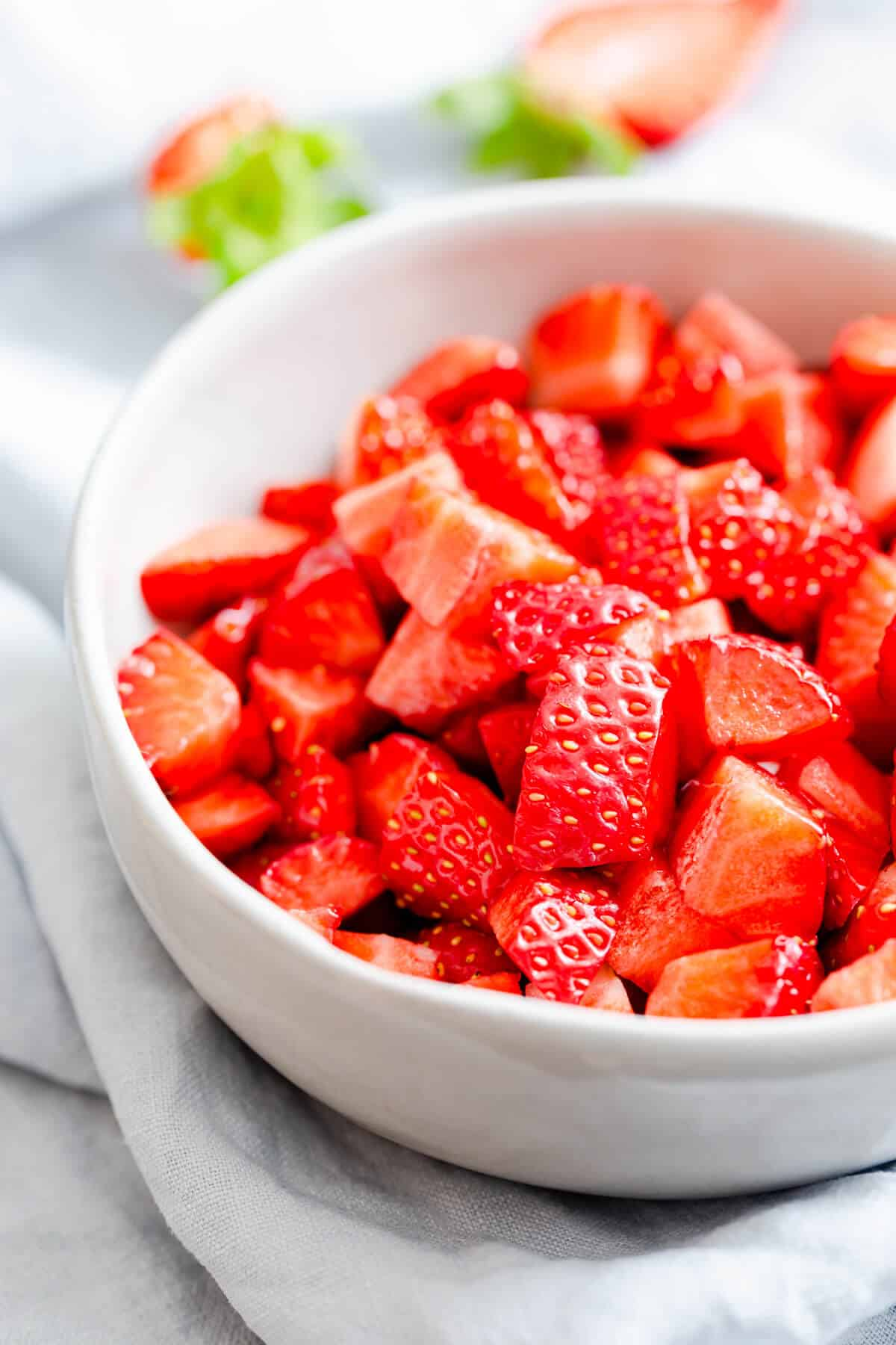side close up at a bowl with chopped strawberries