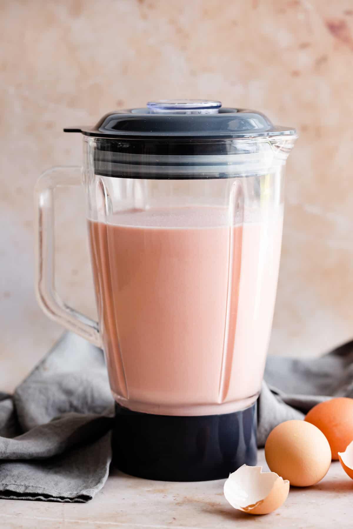 straight ahead shot of a blender jar filled with pink crepe batter
