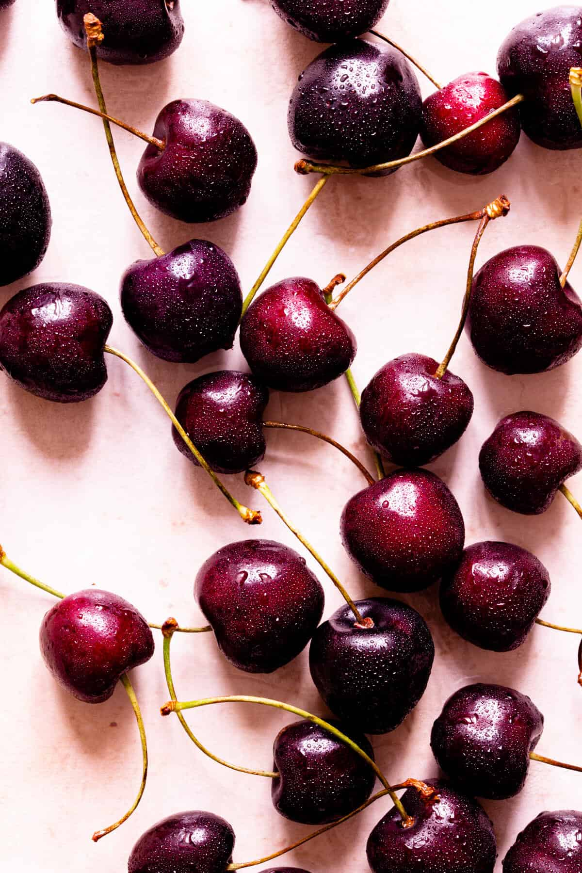 top view of fresh cherries with stems attached