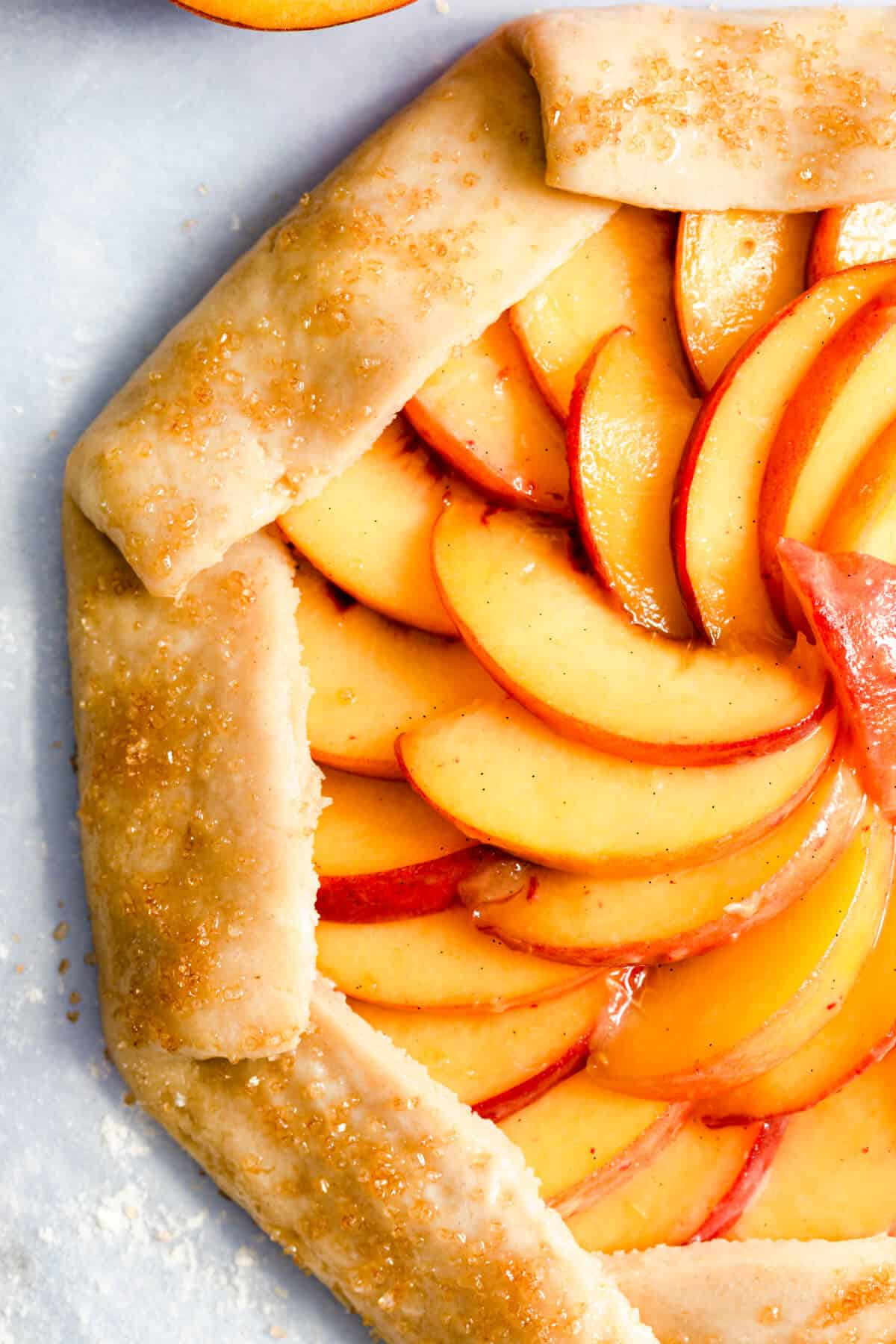 top view super close up of unbaked peach galette