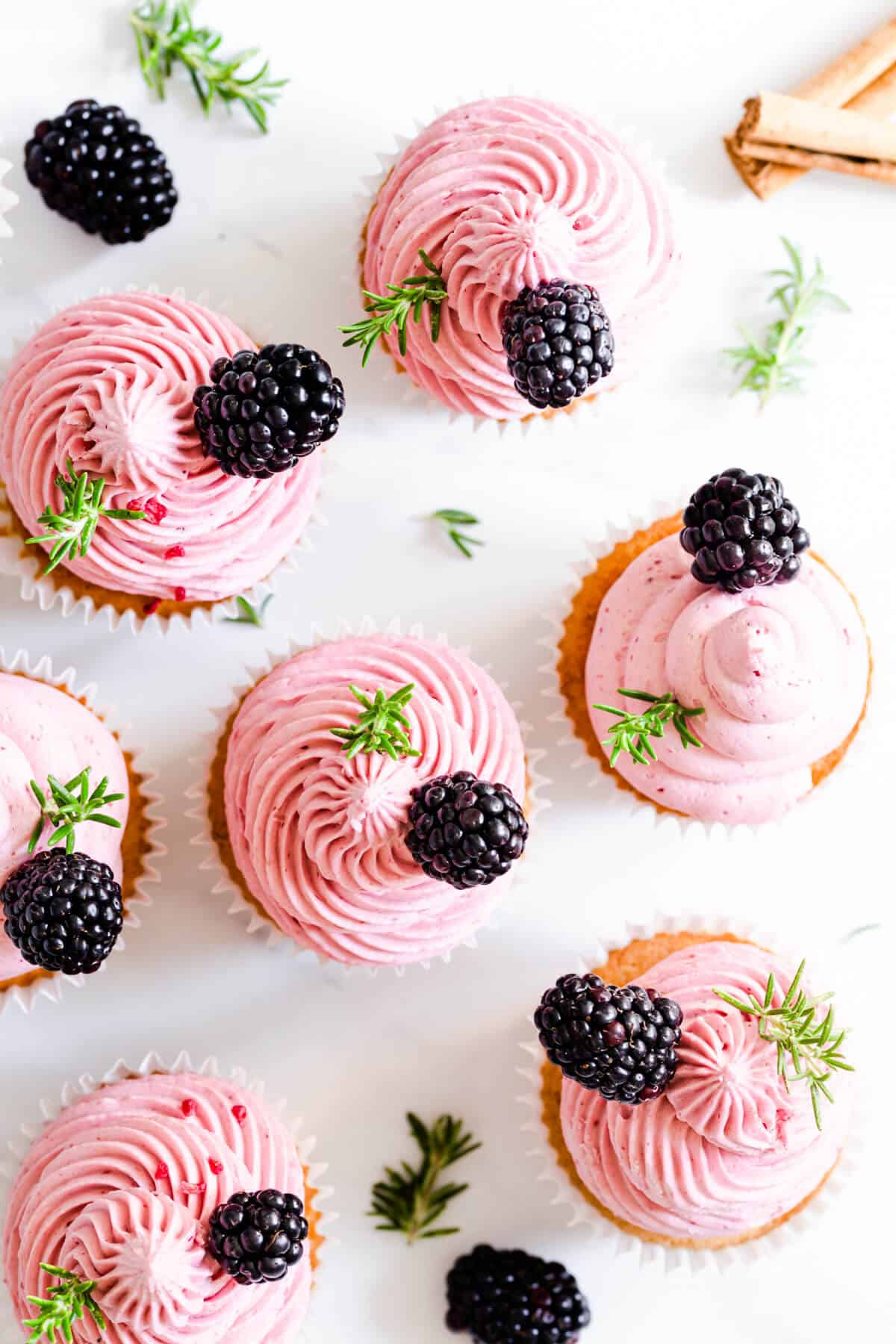 top view of spiced apple cupcakes with blackberry buttercream