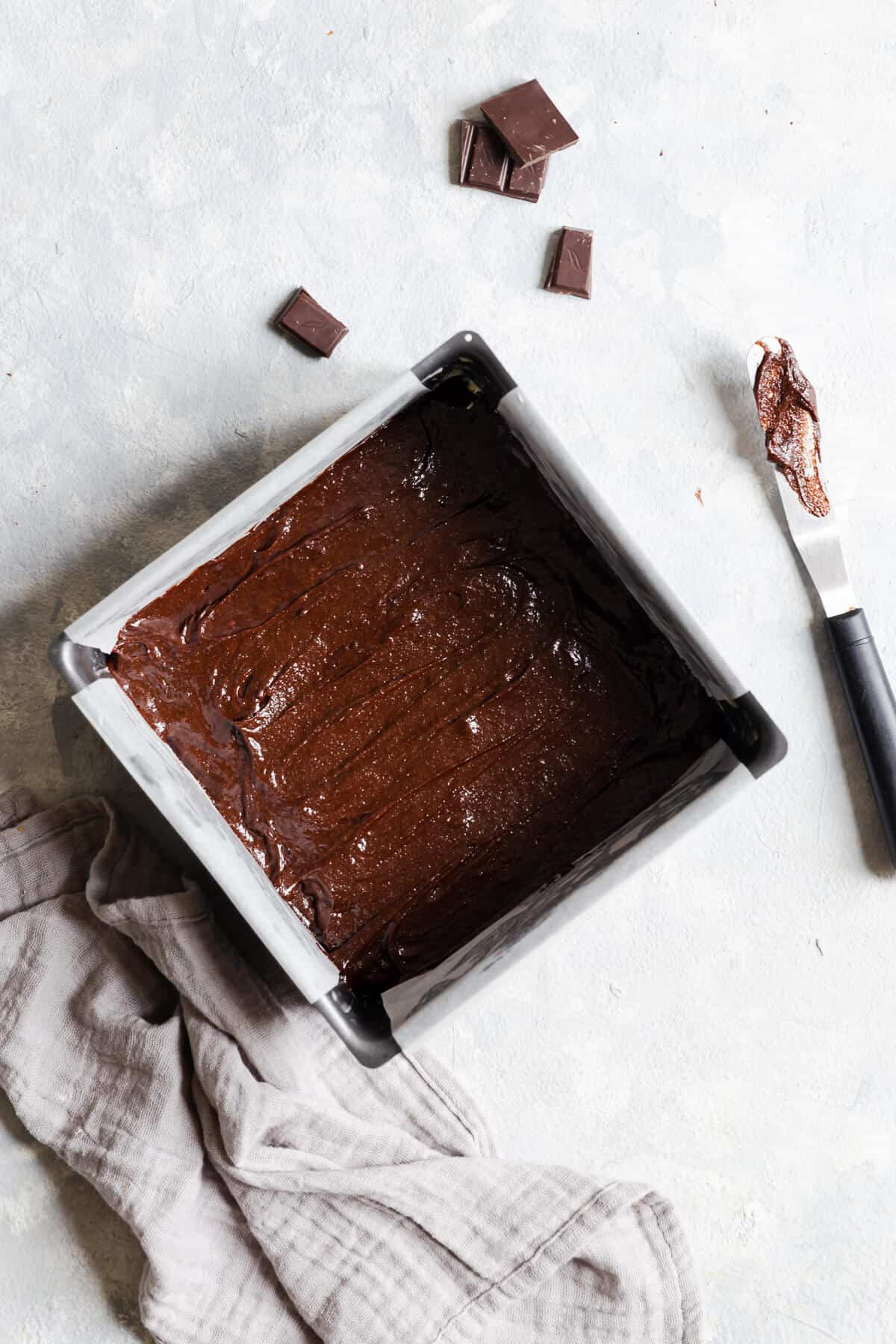 overhead shot of brownie batter in a baking tin