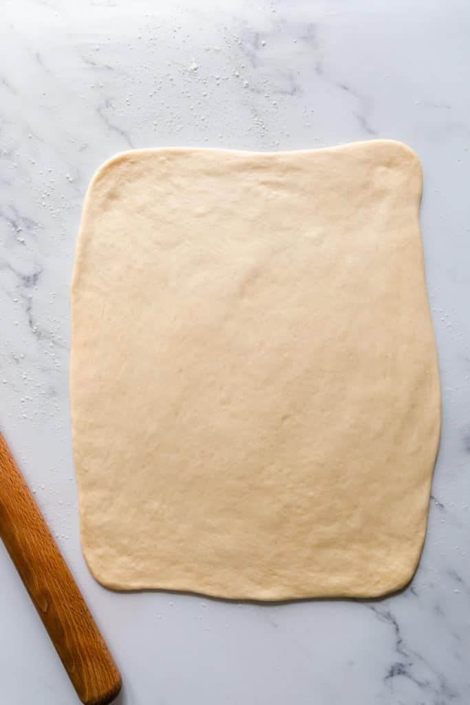 top view of a soft dough rolled into large rectangle