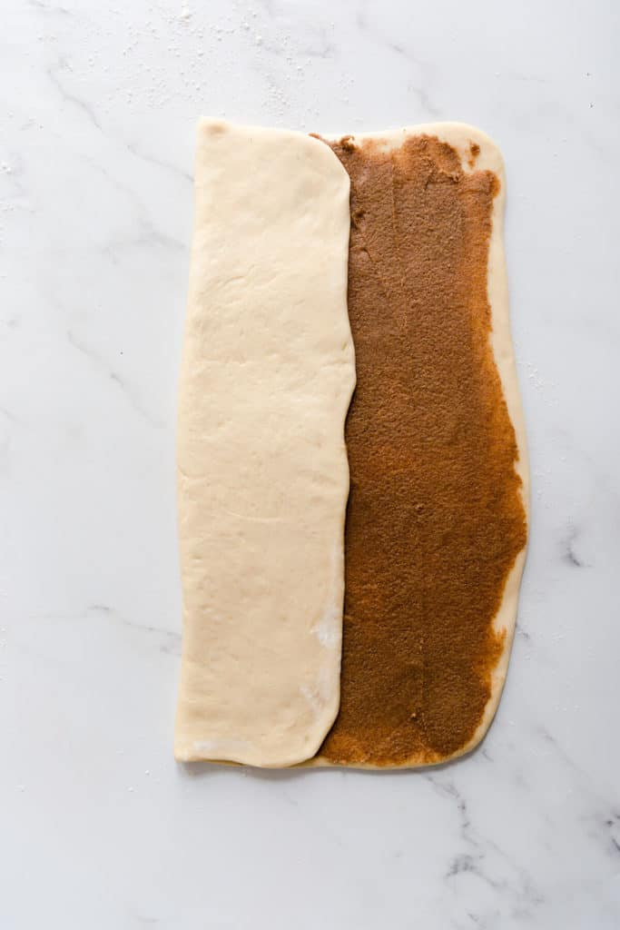 overhead shot of a large rectangle of dough being folded
