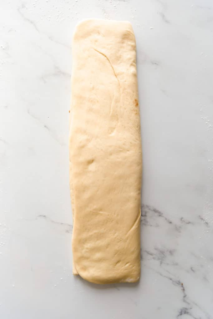 top view of soft dough folded into rectangle