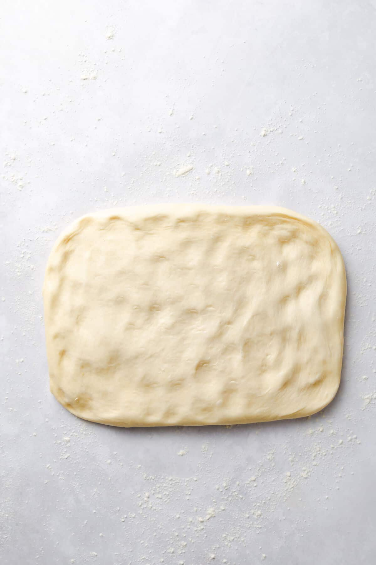 top view of soft dough stretched into rectangle