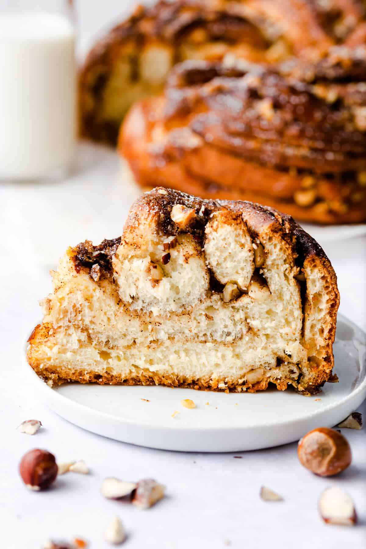 side super close up of a slice of cinnamon and hazelnut bread on a small plate