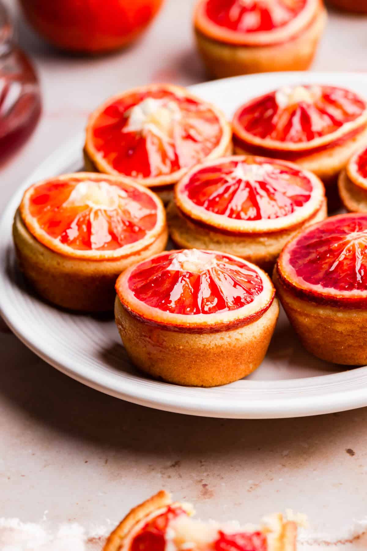 straight ahead angle photo of blood orange and semolina cakes on a plate