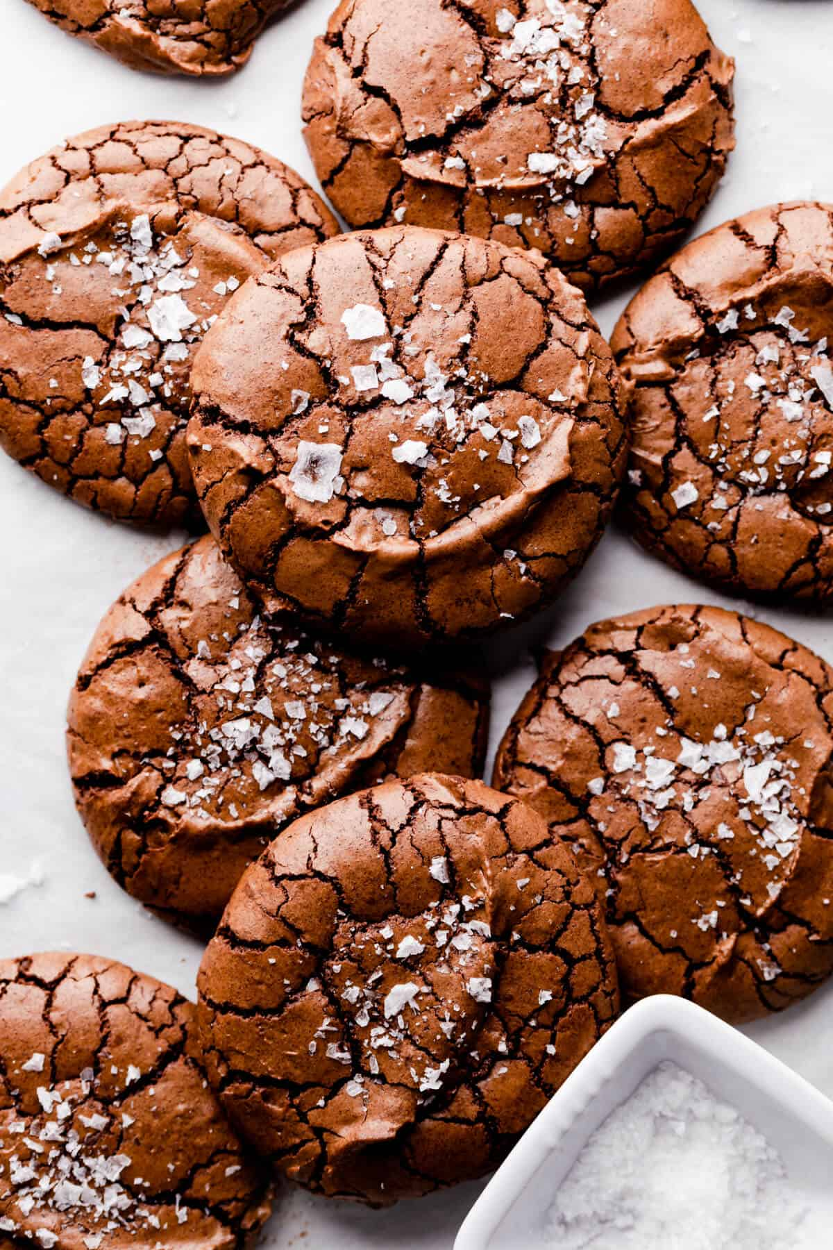 overhead close up at chocolate brownie cookies topped with some flaked sea salt