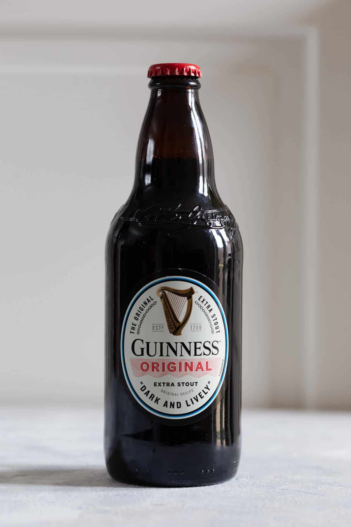 straight ahead close up photo of a bottle of Guinness