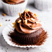 45 degree angle super close up at a chocolate cupcake topped with chocolate buttercream
