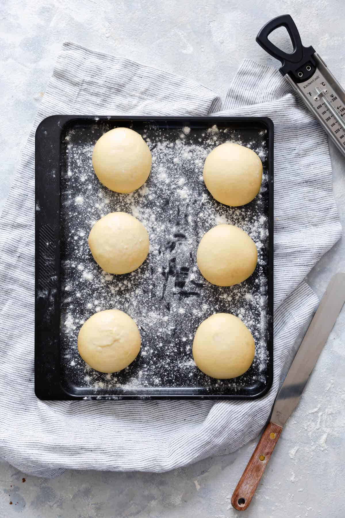 top view of 6 risen dough balls for small batch doughnuts