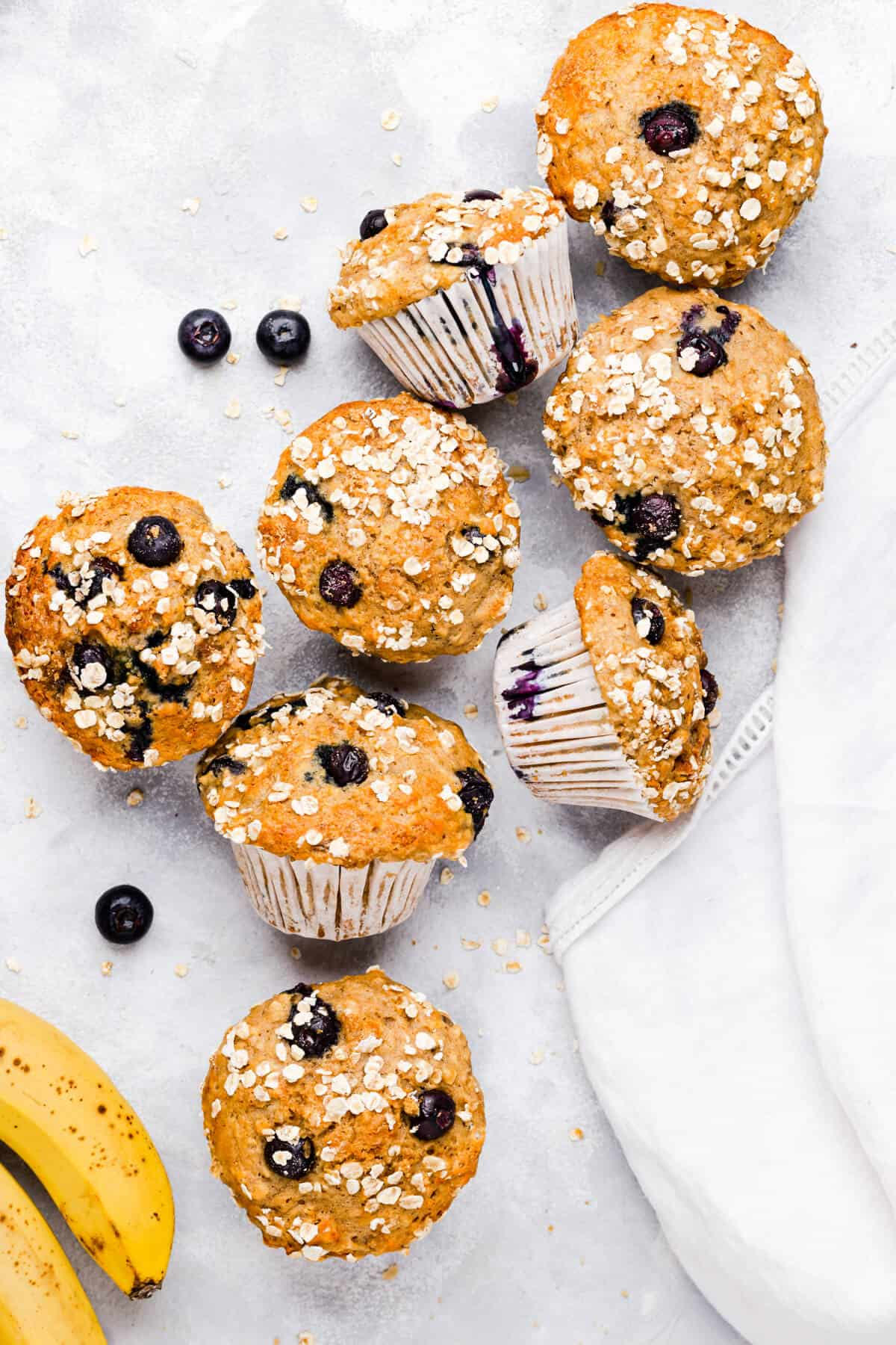 top view of muffins with blueberries and bananas