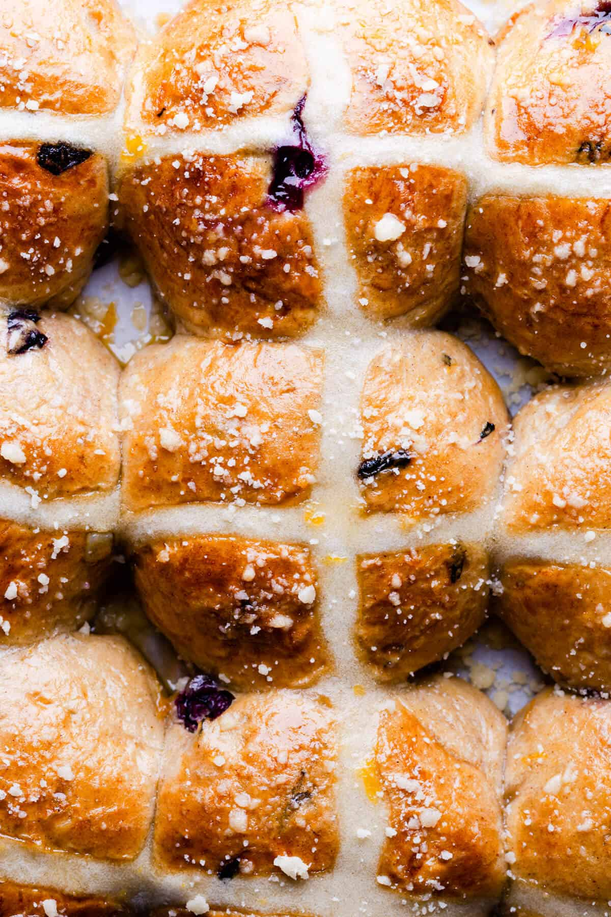 top view close up of buns with blueberries and cross pattern