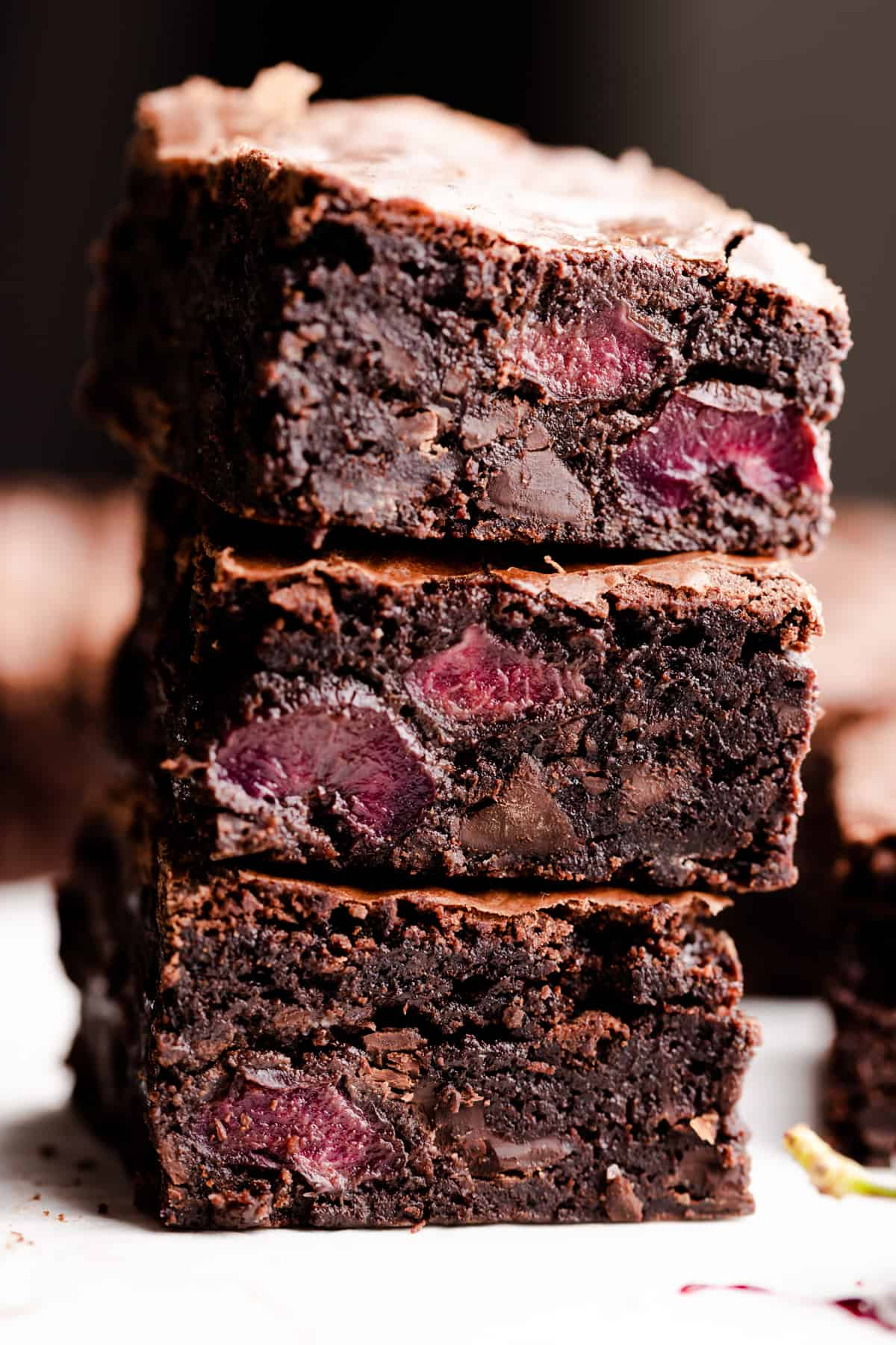 side super close up at a stack of three chocolate cherry brownies