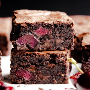 super close up at two slices of chocolate cherry brownies