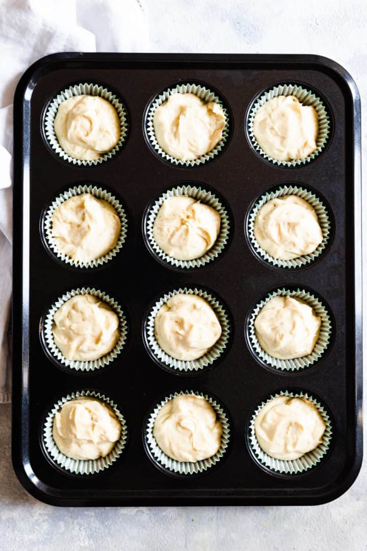 top view of a 12-hole cupcake tin filled with cake batter