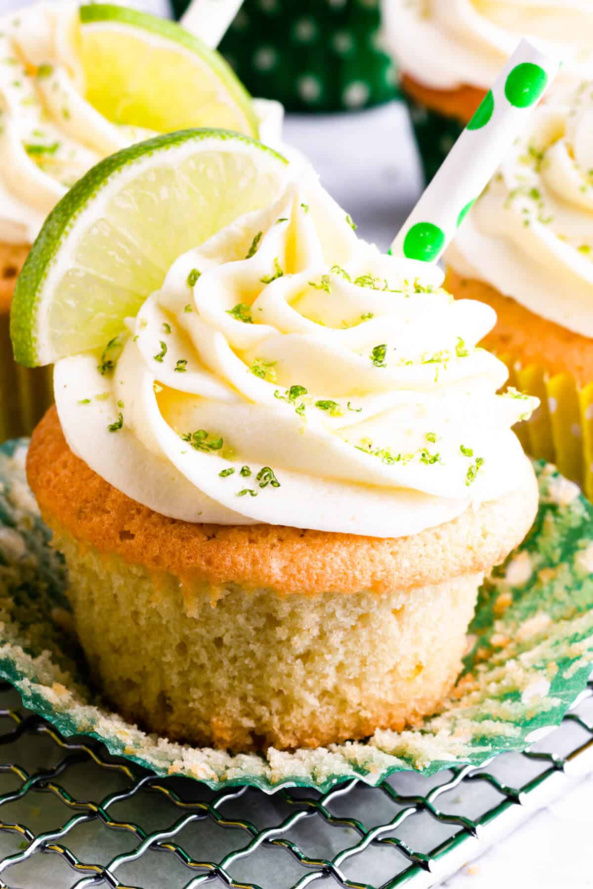 super close up at a cupcake topped with butter icing and lime zest