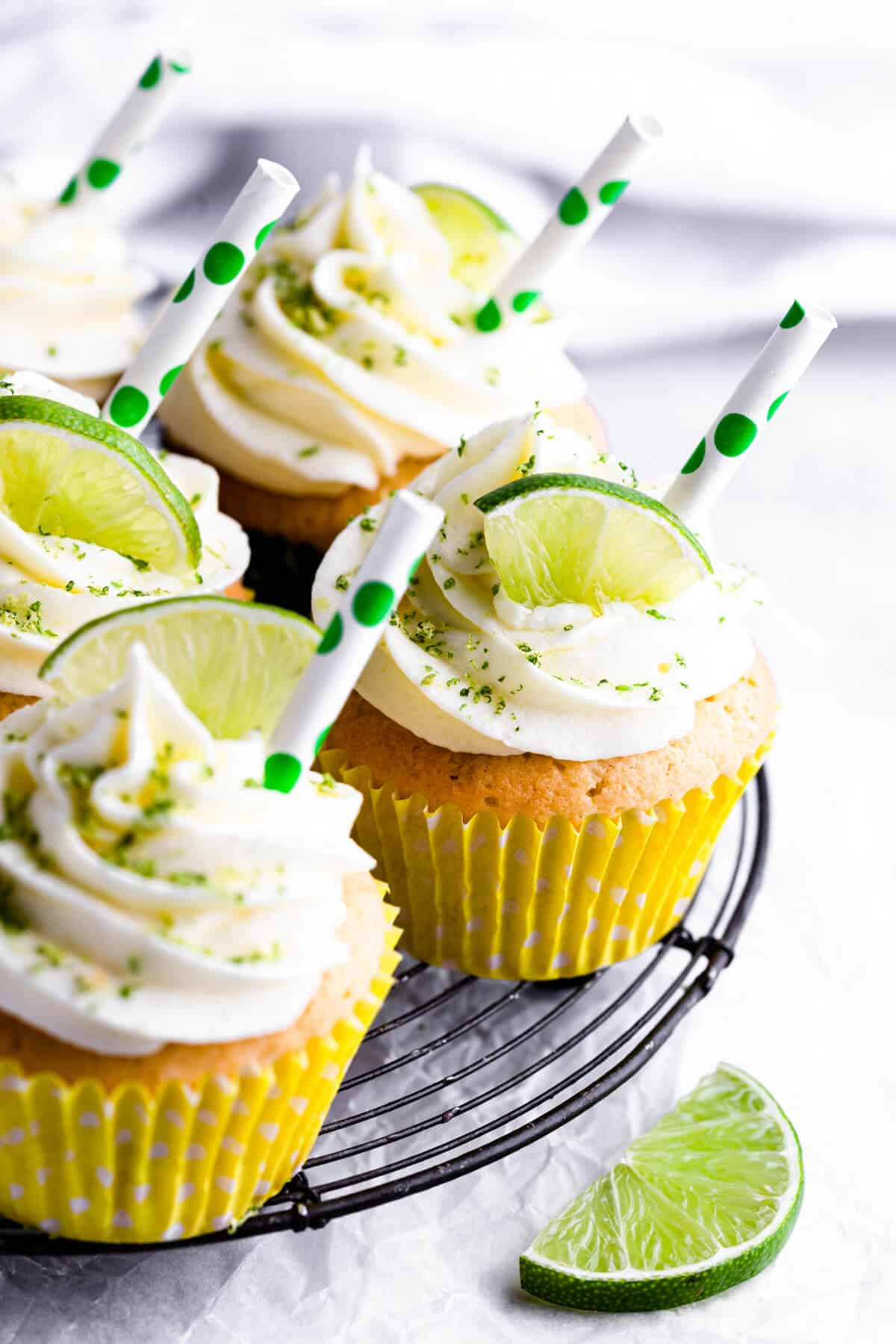 side view of gin and tonic cupcakes on a metal cooling rack