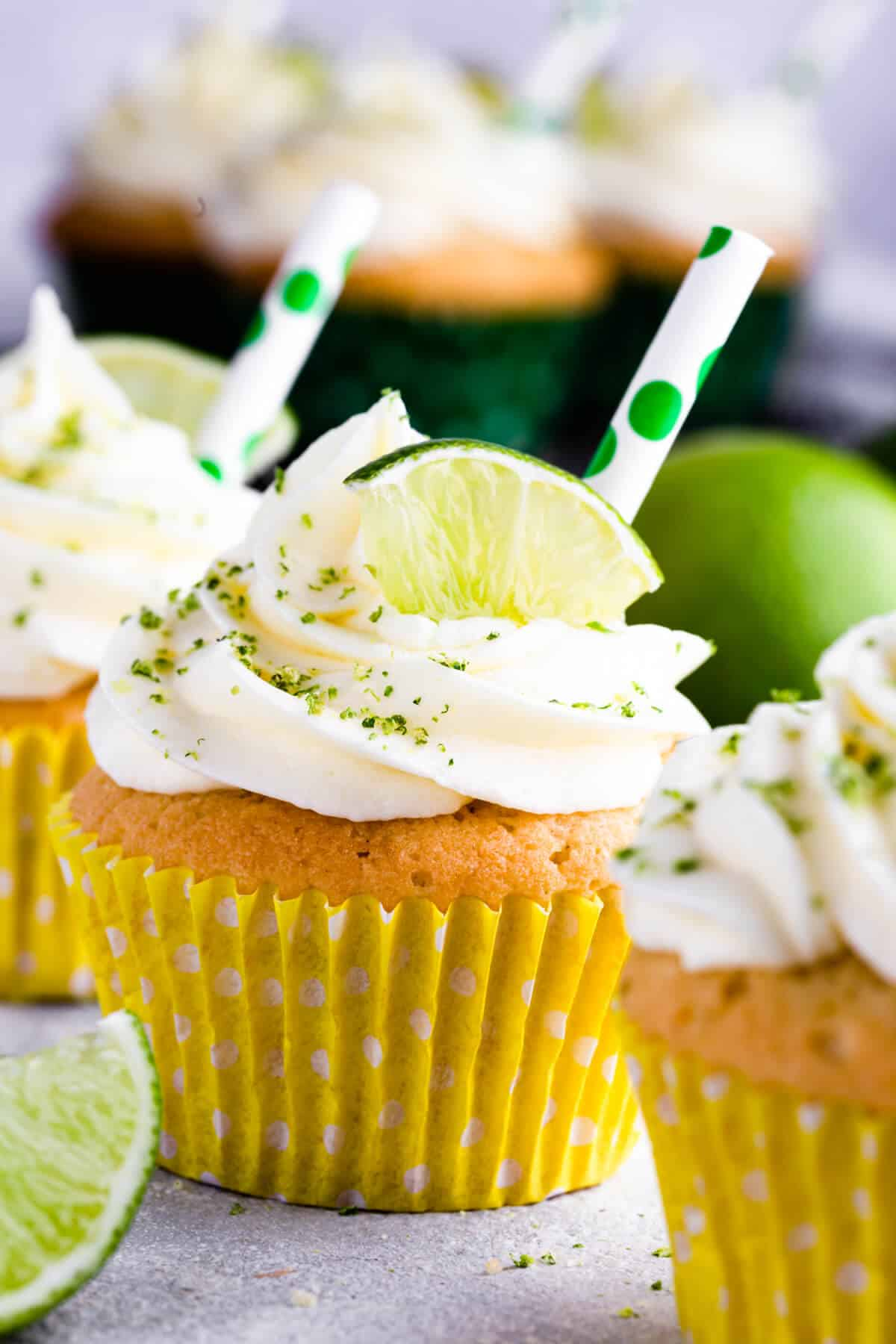super close up at a gin and tonic cupcake in yellow paper case