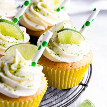 side close up at a gin and tonic cupcake with slice of lime