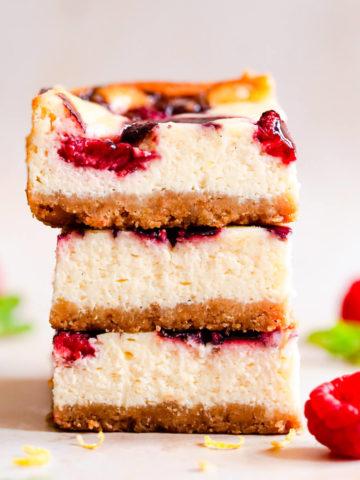 straight ahead close up of stack of three raspberry cheesecake bars