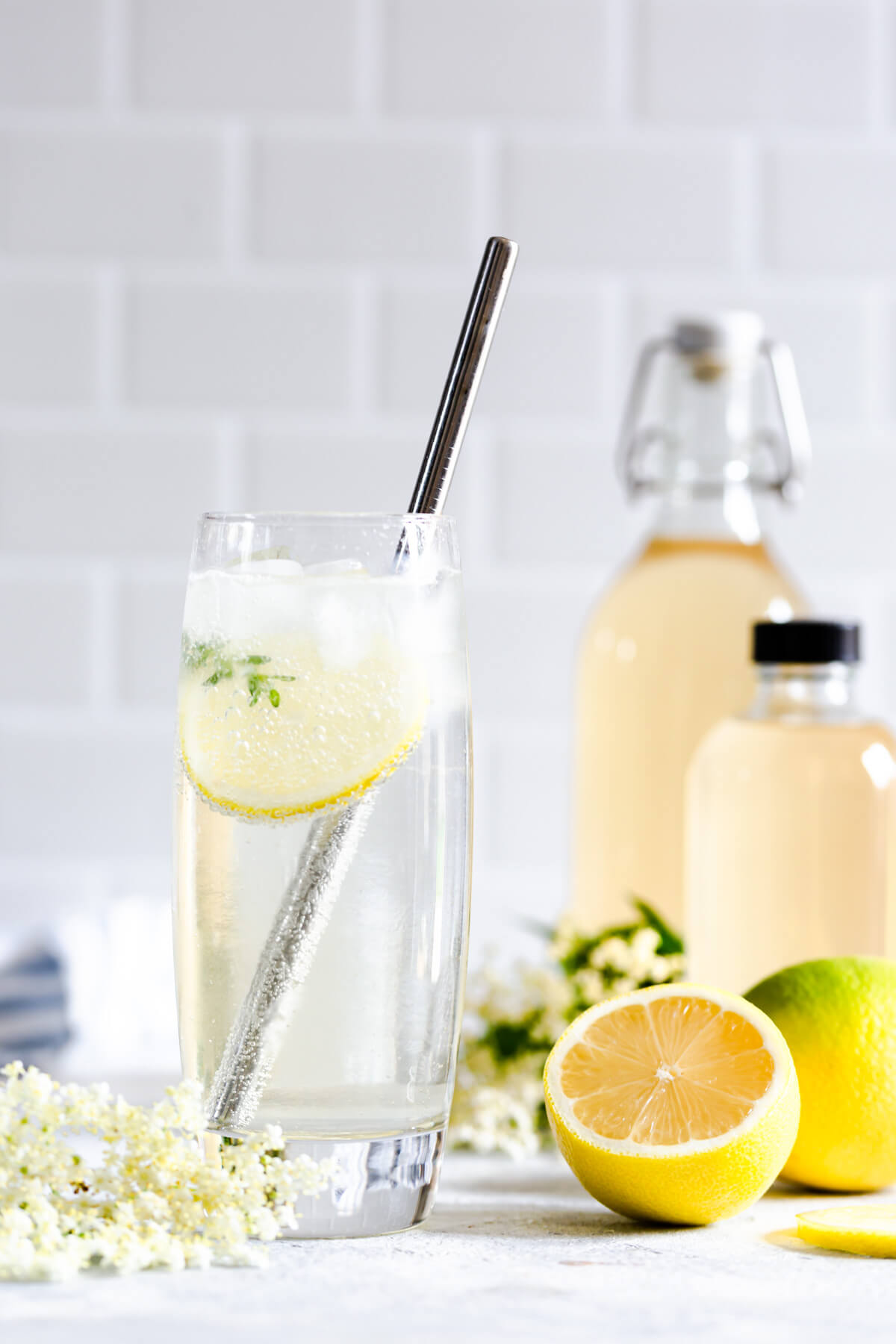 side close up at a tall glass with elderflower cordial and sparkling water