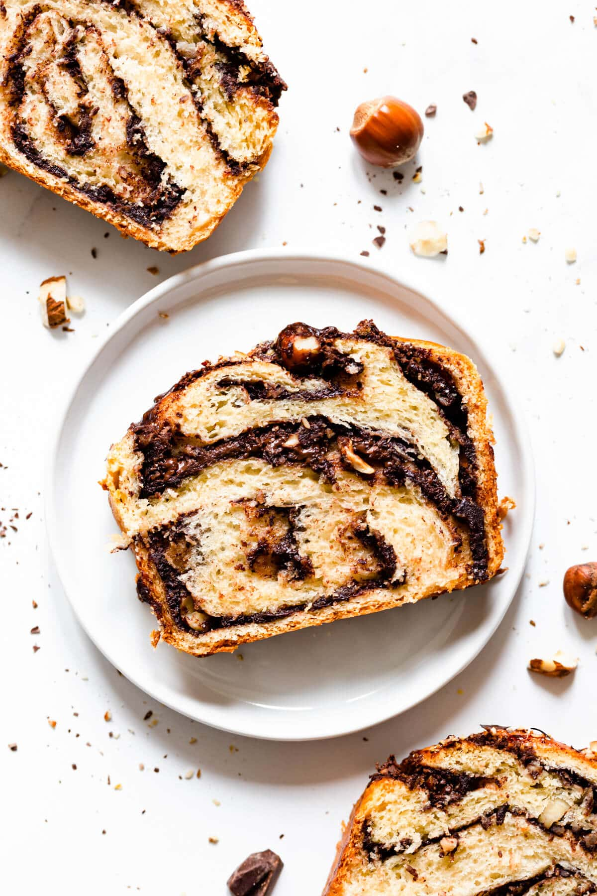 top view close up of slice of nutella babka with hazelnuts