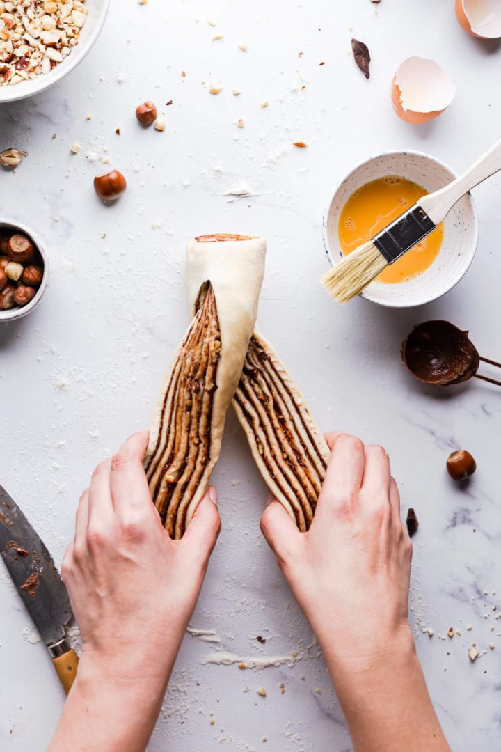 overhead view of a person twisting the nutella babka dough