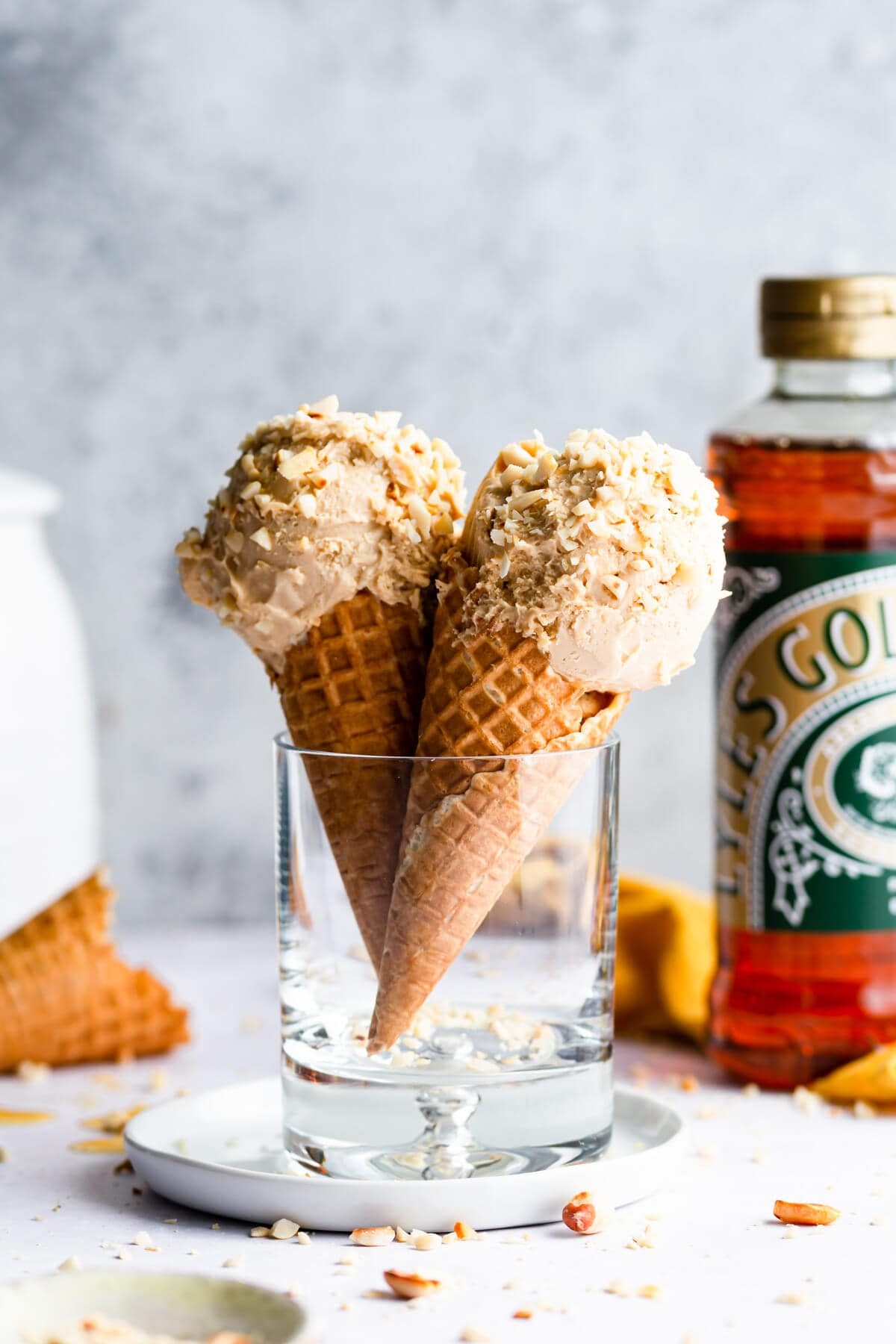 side close up at two peanut butter ice cream cones in a glass