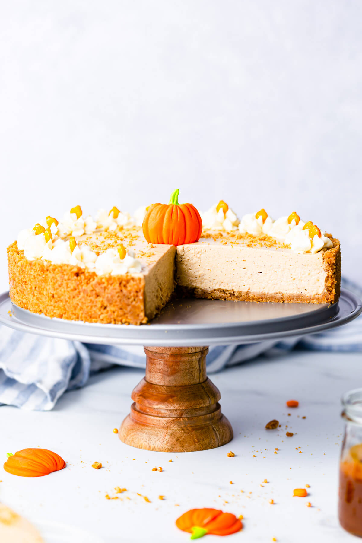 straight ahead close up at no bake pumpkin cheesecake on a small cake stand
