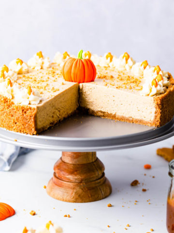 straight ahead super close up at a no bake pumpkin cheesecake with couple of slices cut off
