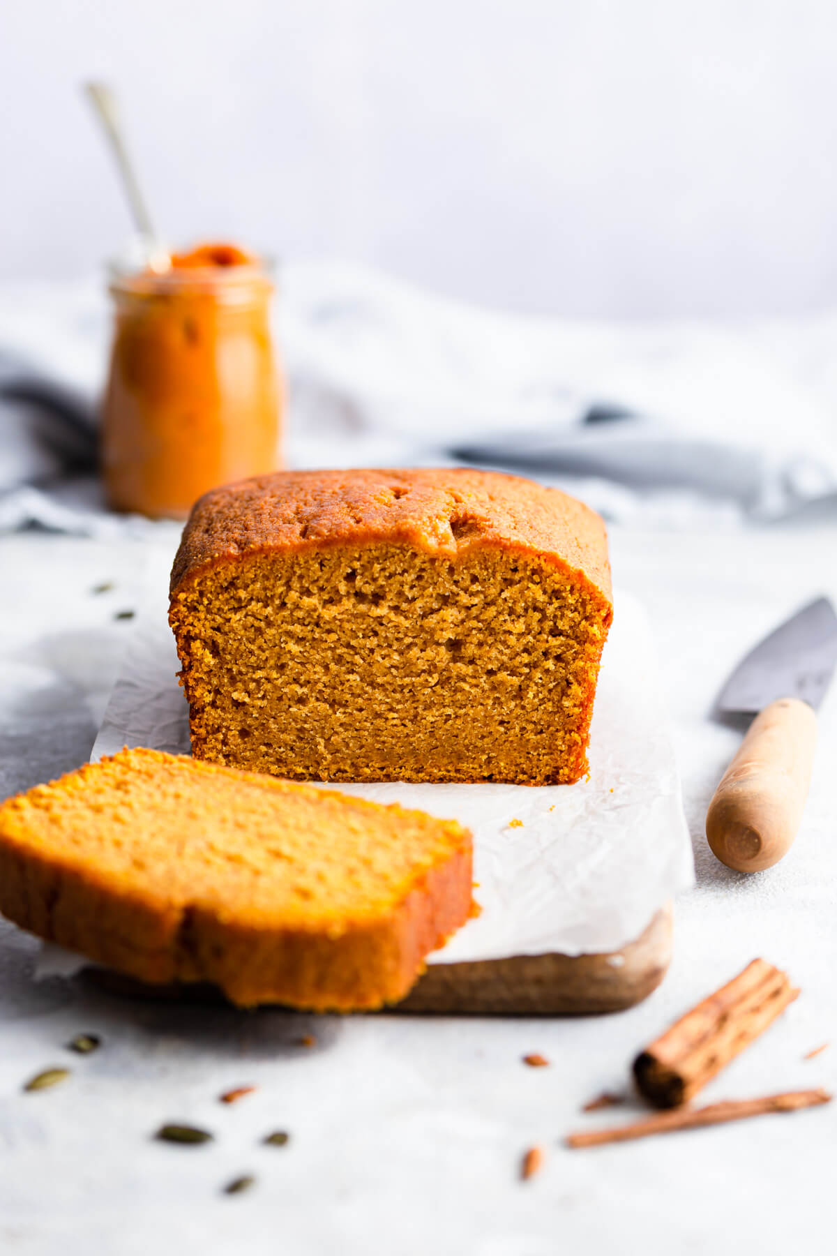 side angle photo of pumpkin loaf cake with slice cut off