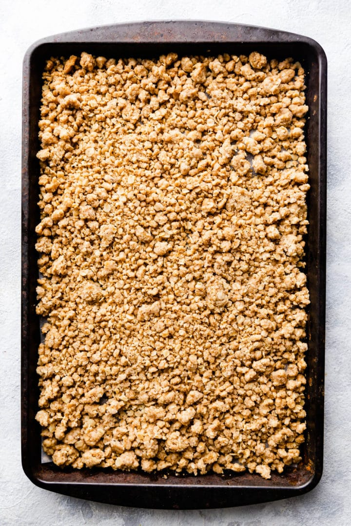overhead shot of baked crumble topping on a baking tray