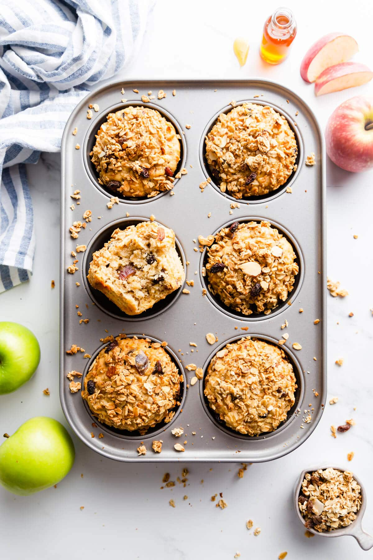 top view of baking tin with 6 apple and granola breakfast muffins inside