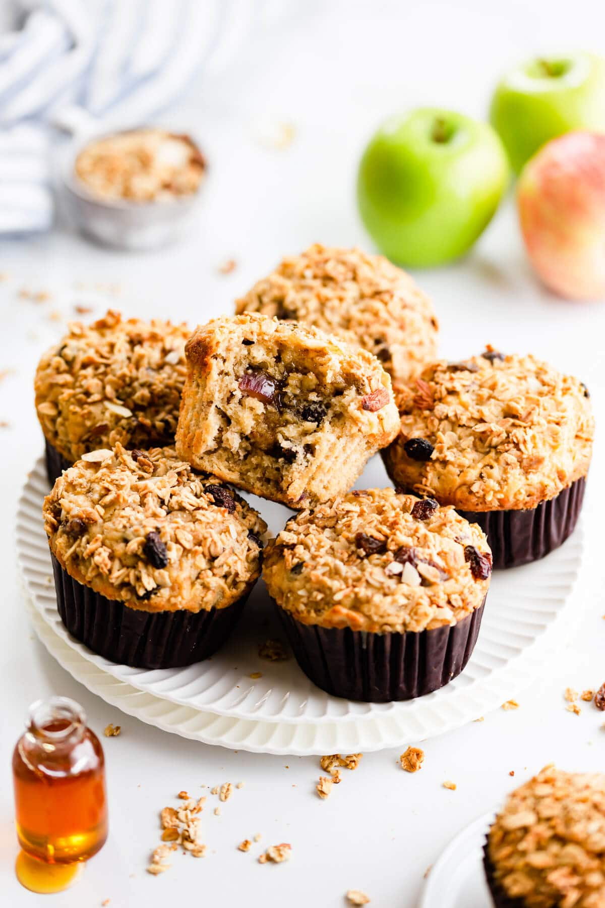 45 degree angle close up of apple and granola breakfast muffins on a plate