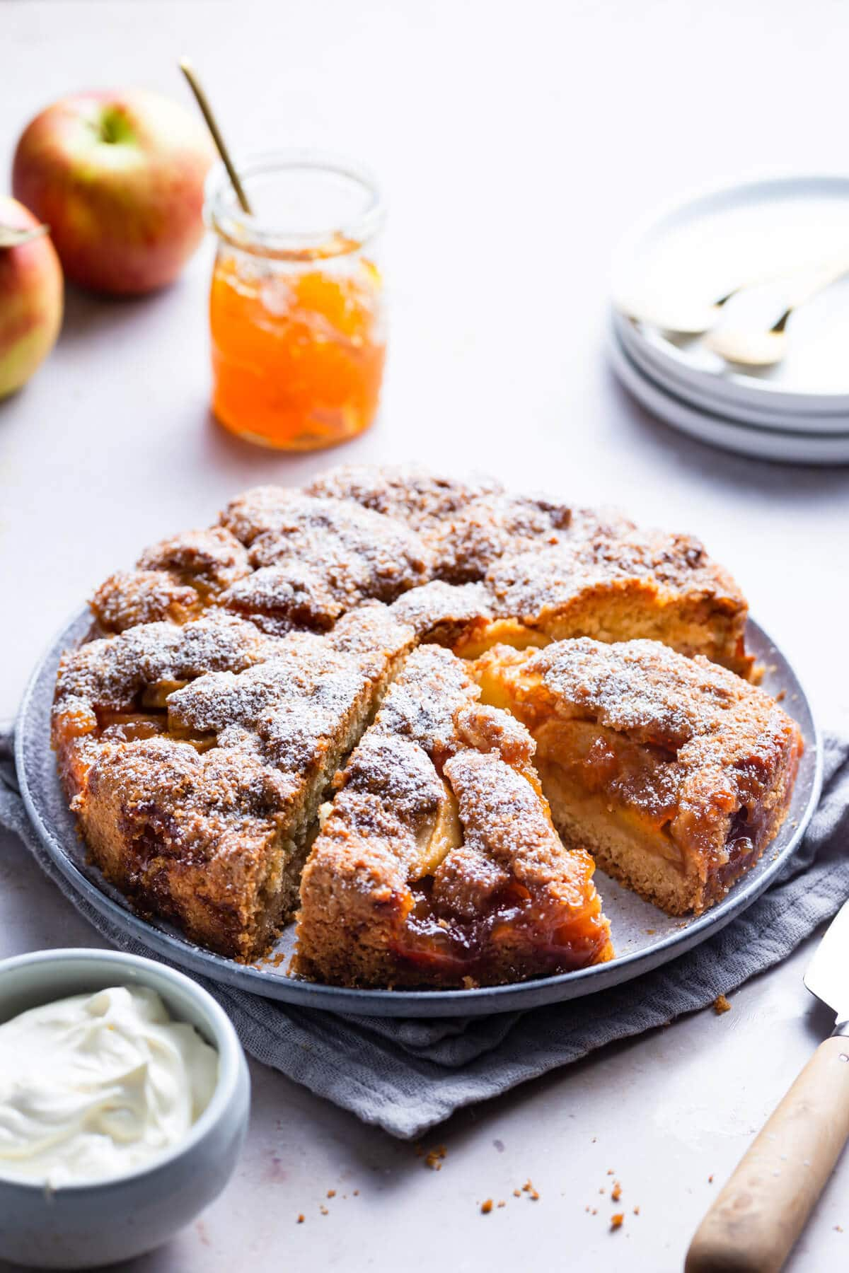 45 degree angle view of an apple cake on a round plate