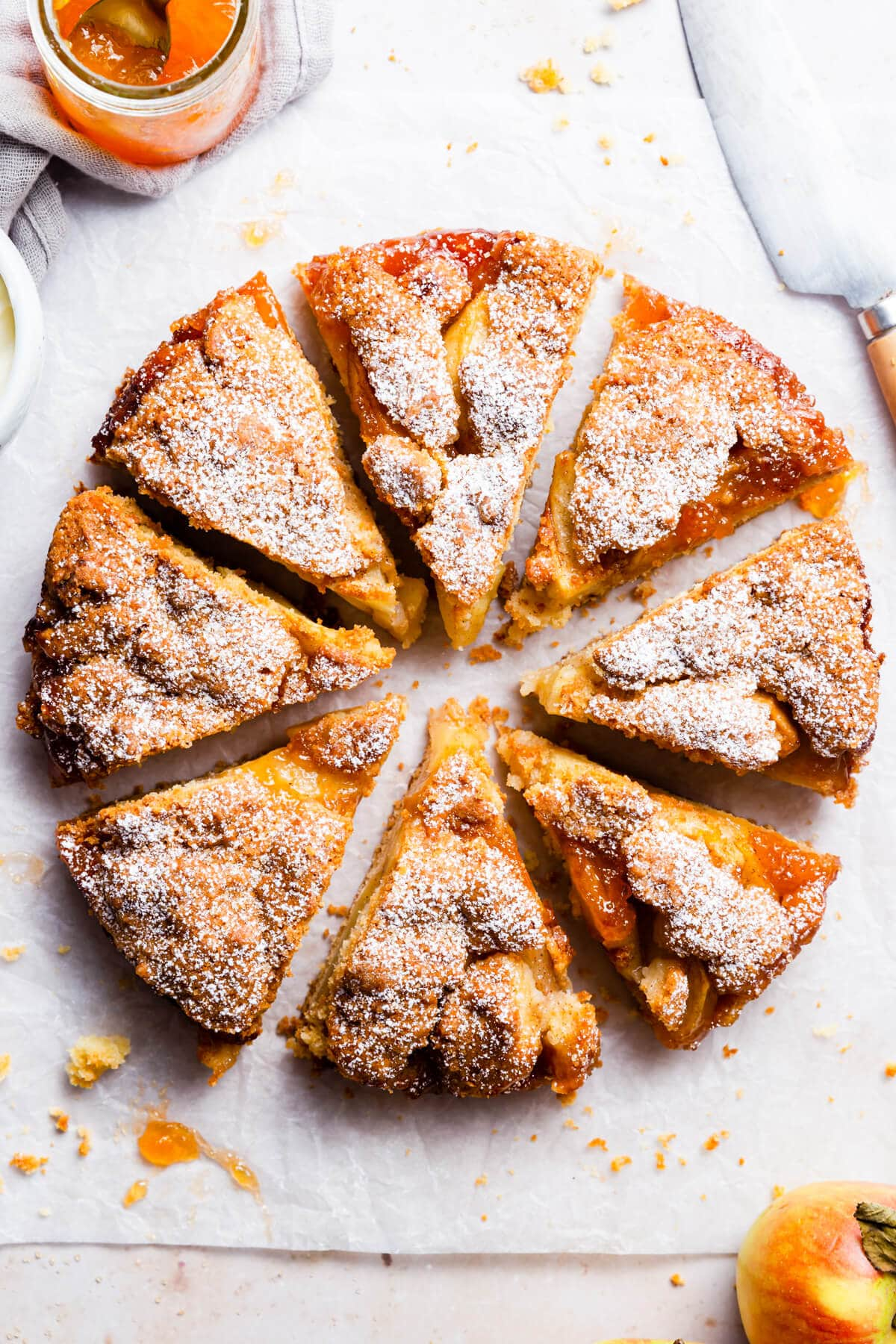 overhead close up at easy apple cake cut into eight individual slices