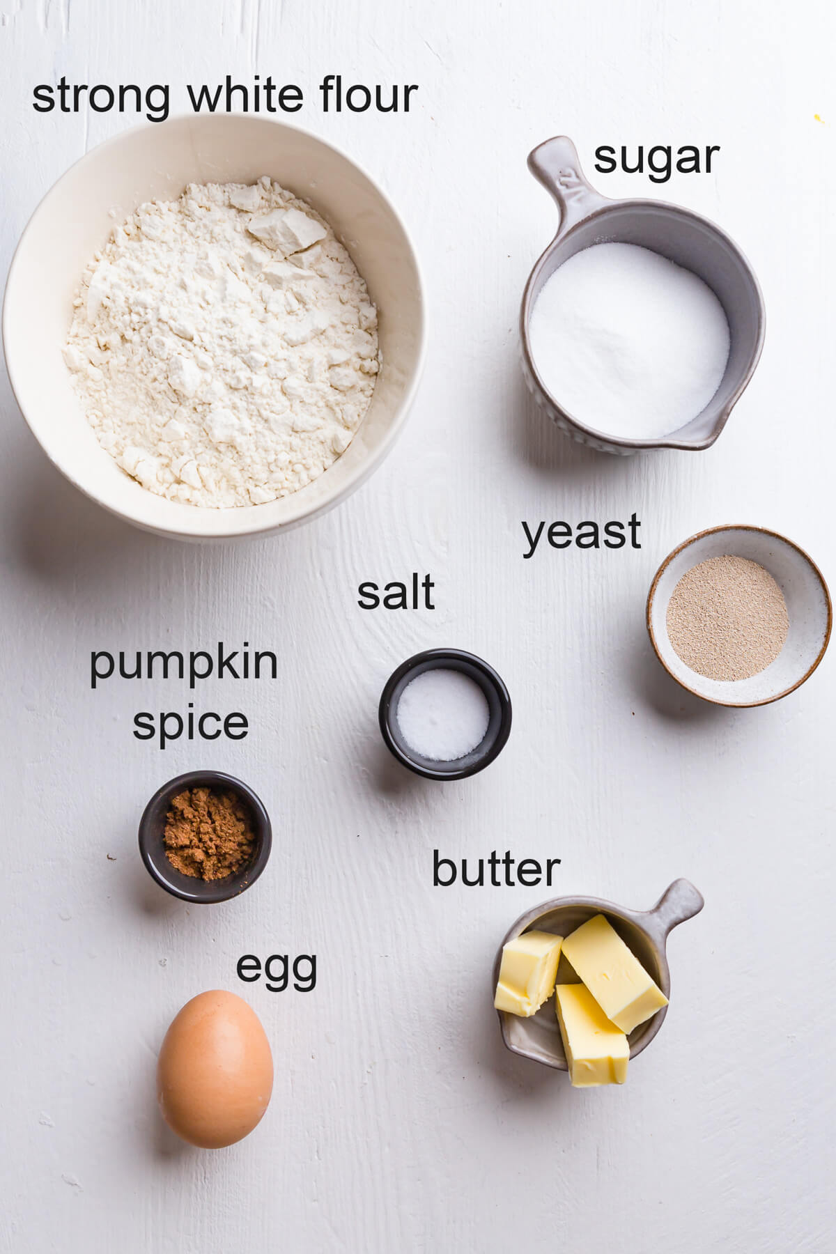 top view of the ingredients for pumpkin spice doughnuts